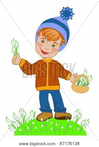 Boy picking snowdrops