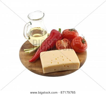 Vegetables, Oil And Cheese On Cutting Board, Isolated On White Background.