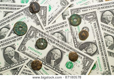 Antique  Coins With Portraits Of Emperors And Banknotes Of Dollars