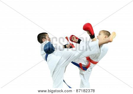 Young athletes with overlays on hands are training blows legs