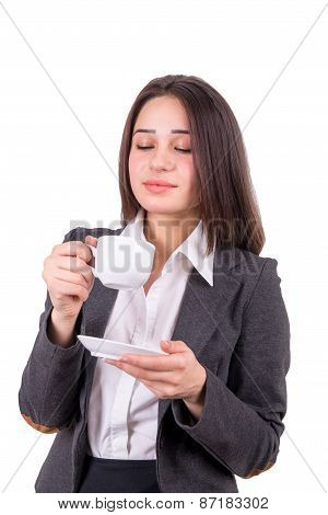 Young Business Woman Smells The Aroma Of The Drink From A Cup