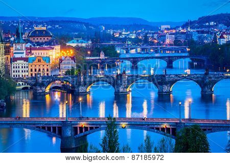 Travel Prague concept background - elevated view of bridges over Vltava river from Letn�¡ Park. Prague, Czech Republic in twilight