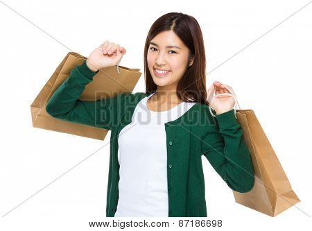 Happy shopper holding shopping bag