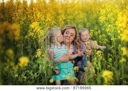 Mother With Children In Nature