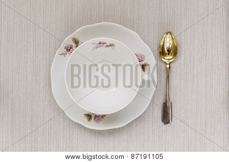 Empty Cup On A Saucer And Spoon