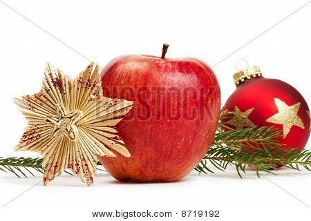 apple straw star red christmas bauble and a branch
