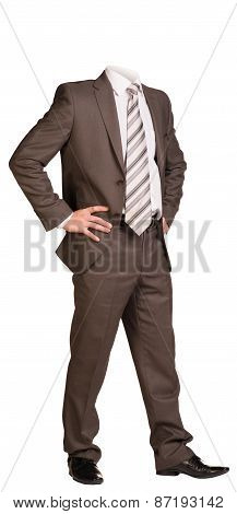 Businessman in suit without head, standing with hands on hips. Isolated
