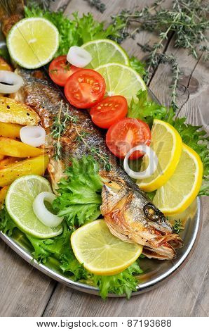 Grilled Fish With Vegetables On Rustic Table