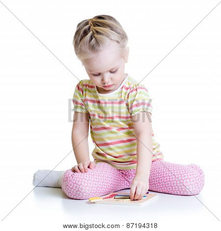 Little Cute Girl Solving puzzle