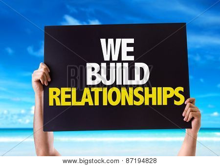 We Build Relationships card with beach background