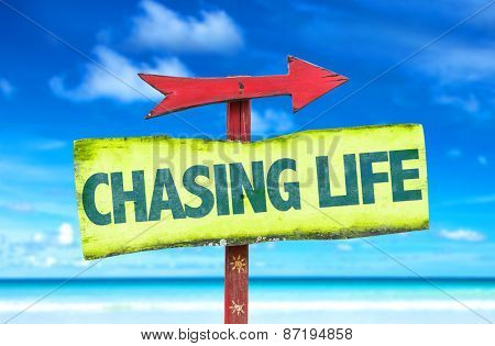 Chasing Life sign with beach background