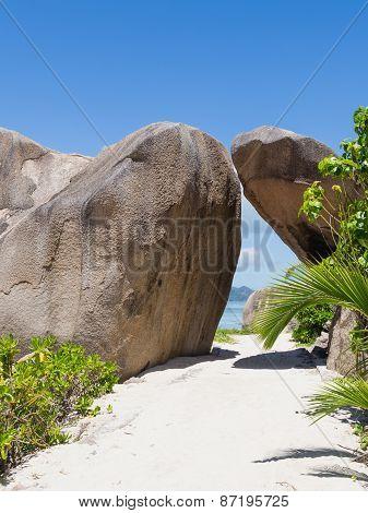 Tunnel Of Granite Stones On The Beach