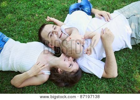 Happy Family Outdoors  Mum Dad And Baby