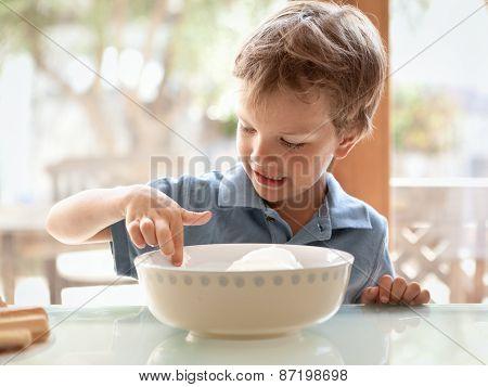 Boy Makes A Cake In Kitchen