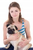 image of pug  - young beautiful woman holding pug dog isolated on white background - JPG