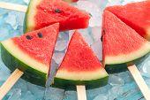 stock photo of popsicle  - watermelon popsicle yummy fresh summer fruit sweet dessert on vintage old wood teak blue - JPG