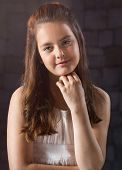 foto of ten years old  - Ten year old caucasian girl with long hair posing in the studio - JPG