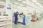 foto of cashiers  - Supermarket store blur background Cashier counter with customer Vintage filter effect - JPG