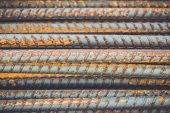 stock photo of reinforcing  - Macro steel rods or bars used to reinforce concrete - JPG