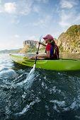pic of kayak  - Young lady paddling hard the sea kayak - JPG