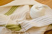 image of hook  - Crocheted scarf crochet hooks and skein on the table - JPG
