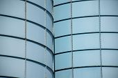 stock photo of silos  - particularly of a silo with blue rectangles that can be used to insert sections of a slide - JPG