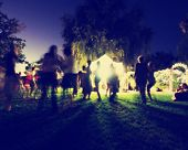 picture of moonlit  -  people mingling at a free concert by local musicians toned with a retro vintage instagram filter effect app or action  - JPG