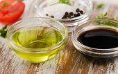 image of vinegar  - Bowl of Balsamic vinegar salt and olive oil on a wooden table - JPG