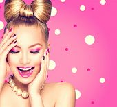 stock photo of bowing  - Beauty fashion happy model girl with funny bow hairstyle - JPG