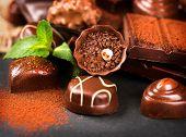 Постер, плакат: Chocolates Chocolate Assortment of fine chocolate praline in dark and milk chocolate with vanilla