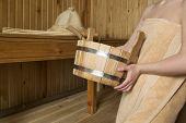 picture of sauna woman  - Beautiful woman in sauna bath accessories - JPG