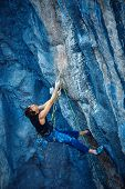 image of climbing wall  - rock climber climbs on a rocky wall - JPG