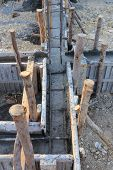 image of concrete pouring  - construction house reinforcement metal framework for concrete pouring - JPG