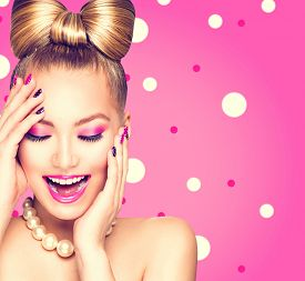 image of bowing  - Beauty fashion happy model girl with funny bow hairstyle - JPG
