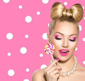 pic of lollipops  - Beauty fashion model girl Eating colourful lollipop - JPG