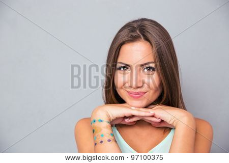 Portrait of a cute smiling girl over gray background