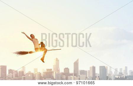 Girl on broom