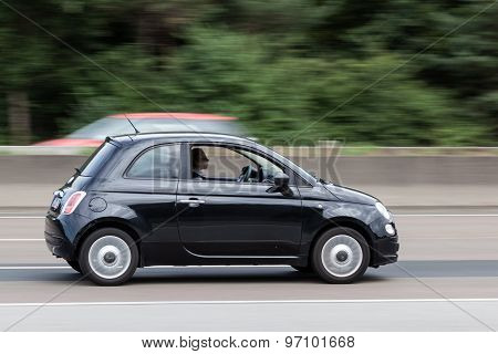 Black Fiat 500 On The Highway