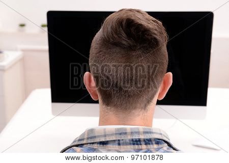 Young man with computer close up