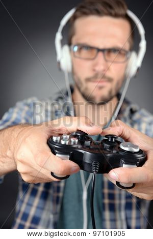 Young man playing video games close up