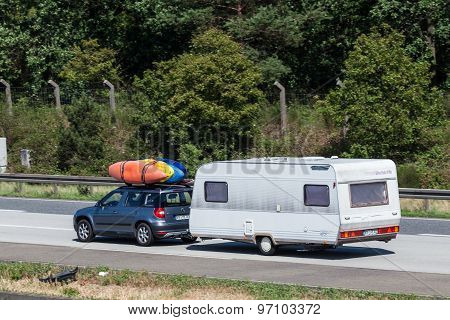 Skoda Yeti With Kayaks And Caravan