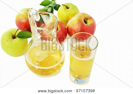 Hard Apple Cider In Glass And Pitcher Over White