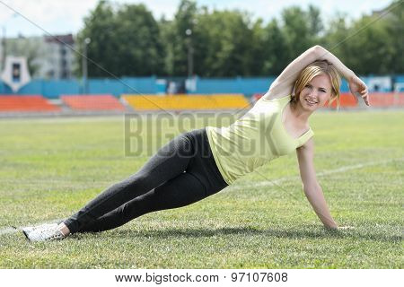 Fitness woman exercising outdoors