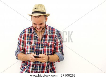 Trendy Happy Guy With Hat Looking At Mobile Phone