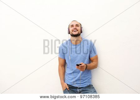 Smiling Young Man With Mobile Phone And Headphones