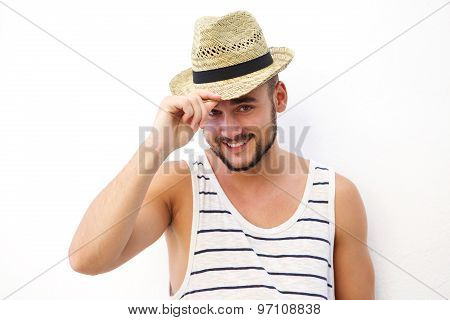Happy Young Man Posing Against White Background With Hat