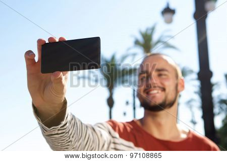 Smiling Young Man Taking A Selfie With His Mobile Phone