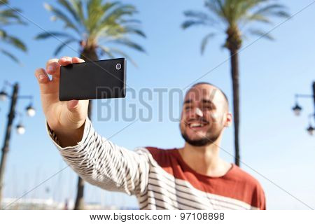 Happy Young Man Taking A Selfie With Cell Phone