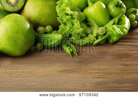 Fresh green food on wooden background