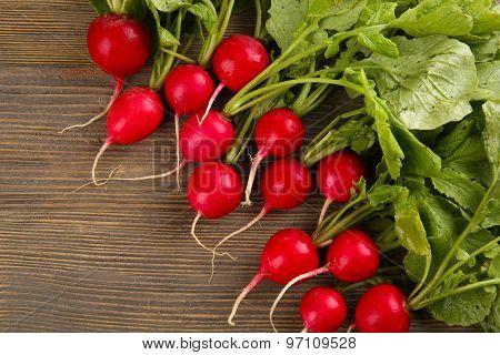 Fresh red radish on wooden table, closeup